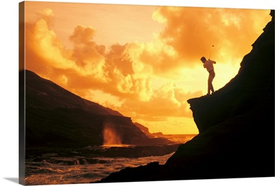 Hawaii, Golfer Standing On A Cliff And Swinging A Golf Club