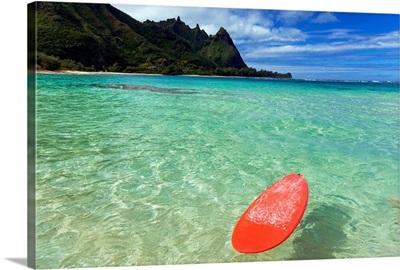 Hawaii, Kauai, Haena Beach, Red Surfboard Floating In Shallow Ocean