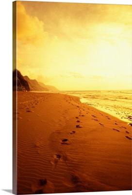 Hawaii, Kauai, Na Pali Coast, Beach At Sunset With Footprints In Sand
