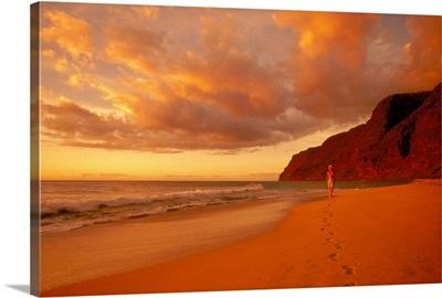 Hawaii, Kauai, Polihale Beach At Sunset, Woman Walking Down Shoreline