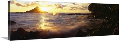Hawaii, Maui, Hana, View Of Sunrise Bursting Over Alau Island From Hana Shoreline