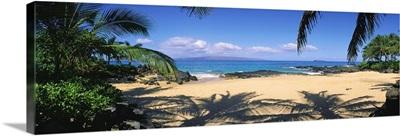 Hawaii, Maui, Makena; Small Secluded Beach Palm Shadows On Sand