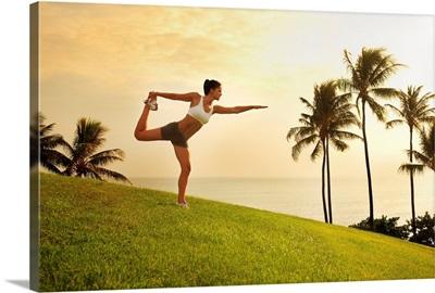 Hawaii, Oahu, Female Doing A Yoga Pose, Stretching On A Hill