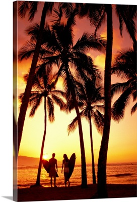 Hawaii, Oahu, North Shore, Couple Walk Under Palms With Surfboards At Sunset