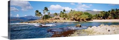 Hawaii, Oahu, Paradise Cove, Thatched Huts Along Shoreline