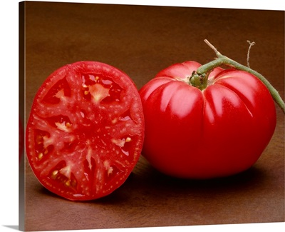 Heirloom tomatoes, whole and halved, Brandywine variety, California