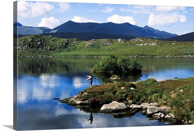 High Angle View Of A Man Fishing In The Lake, Barfinnihy Lake, Republic Of Ireland