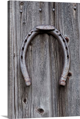 Horseshoe Hanging On A Wooden Wall; Iron Hill, Quebec, Canada
