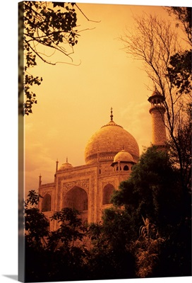 India, Taj Mahal At Dusk, Orange Skies And Dark Trees