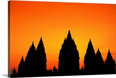 Indonesia, Java, Prambanan, Shiva Mahadeva Temple Silhouetted At Sunset