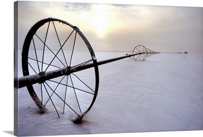Irrigation Equipment Resting In The Snow, Alberta, Canada