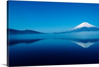 Japan, Mount Fuji, Lake Motosu, misty reflection of snowcapped mountain