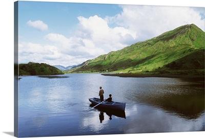 Kylemore Lake, Co Galway, Ireland; People Fishing On A Lake