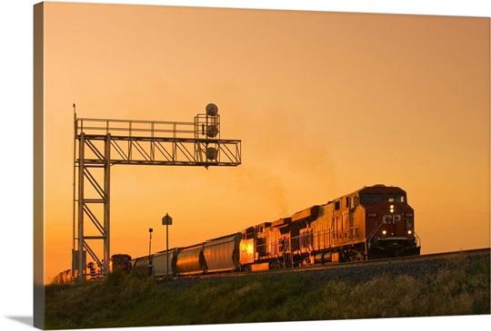 Locomotives Pulling Rail Hopper Cars Pass An Overhead Rail Signal ...