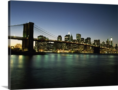 Looking Across The East River And The Brooklyn Bridge At Dusk; New York City, New York