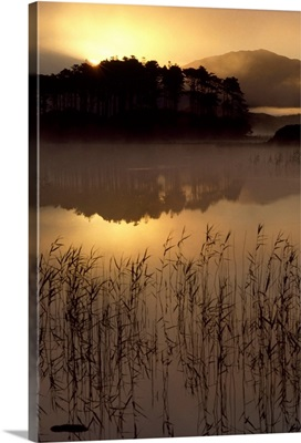 Lough Derryclare, Co Galway, Ireland; Sunset Casting Reflections On Lake
