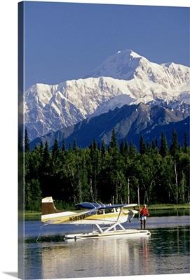 Man fishing on lake from floatplane near Mt. McKinley and Alaska Range, Alaska