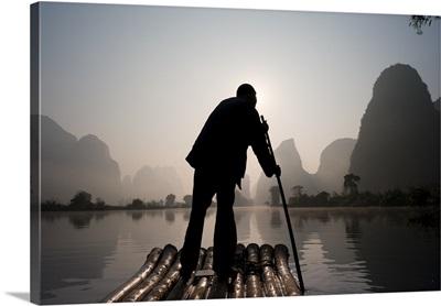 Man On Raft In Mountain Area