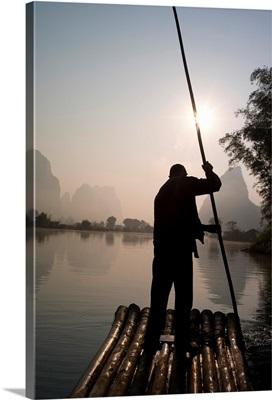 Man On Raft In Mountain Area; Yulong River, Yangshuo, China