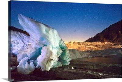 Mendenhall Glacier with a large iceberg and starry sky, Juneau, Southeast Alaska