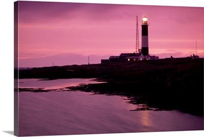 Mew Island, Belfast Lough, County Antrim, Ireland; Lighthouse Beacon At Night