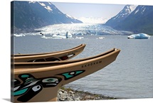 Modern replicas of two Tlingit war canoes in front of the lake by the Spencer Glacier