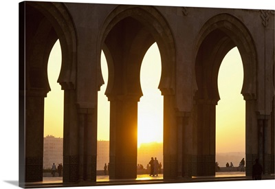 Morocco, Looking through arches of Hassan II mosque at dusk, Casablanca