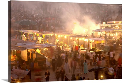 Morocco, People and food stalls in Place Djemaa el Fna at dusk, Marrakesh