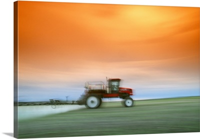 Motion study of a sprayer applying herbicide to a field of early growth canola