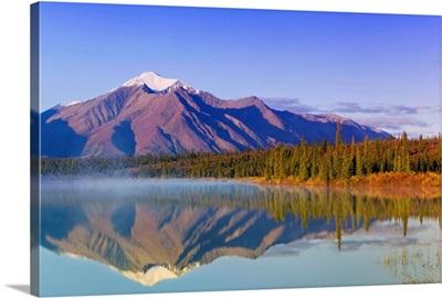 Mountains reflect in Drashner Lake just off the Denali Highway