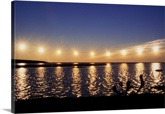 Moving Wall Art multiple exposure of arctic midnight sun moving across horizon