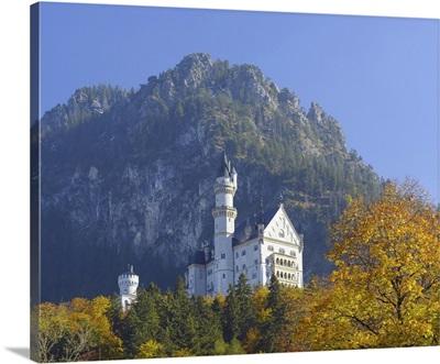 Neuschwanstein Castle Above The Village Of Hohenschwangau In Autumn, Bavaria, Germany