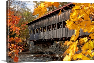 New England, New Hampshire, White Mountains, A Covered Bridge Over A River In Autumn