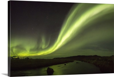 Northern lights over a river and farm in Northeast Iceland; Iceland