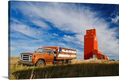 Old Farm Truck And Grain Elevator, Stoughton, Saskatchewan, Canada