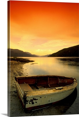 Old Rowboat At Water's Edge With Sunset Background, Alberta, Canada