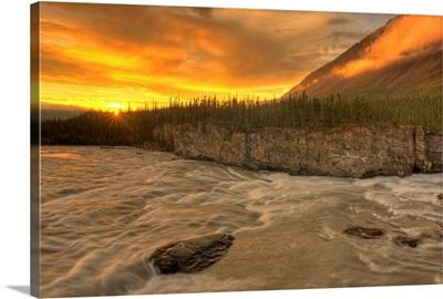 Orange Sunset On Sluice Box Rapids, Northwest Territories, Canada