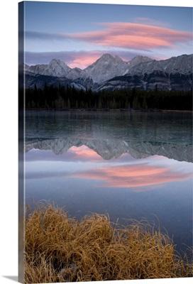 Partially Frozen Spillway Lake At Sunset; Kananaskis, Alberta, Canada