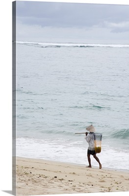 Person Walking On Beach With Fishing Net; Bali, Indonesia