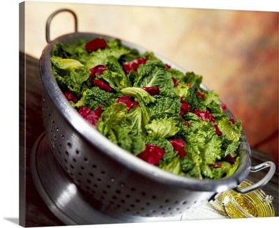 Prepared salad of Romaine lettuce and radicchio in a colander