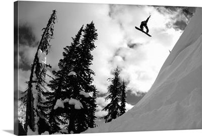Professional snowboarder makes a big air jump, Canada