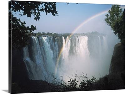 Rainbow In Front Of Victoria Falls; Zimbabwe