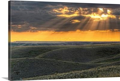Rays Of Sunset Light Between The Clouds, Saskatchewan, Canada