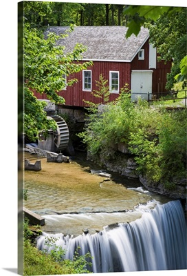 Red Barn With A Mill Wheel And Waterfall; Thorold, Ontario, Canada