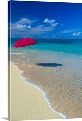 Red Beach Umbrella In Shore Waters