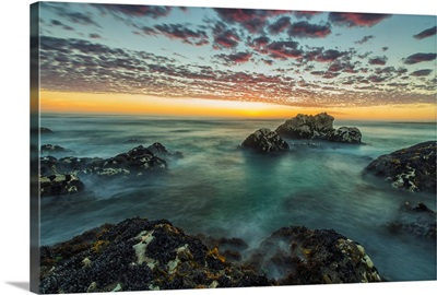 Red clouds of sunset over the ocean along the coast of South Africa, Namakwa