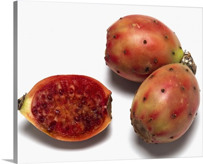Ripe red-green cactus pears, with one sliced open, of the Opuntia genus, California