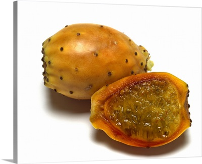 Ripe yellow cactus pears, with one sliced open, of the Opuntia genus, California