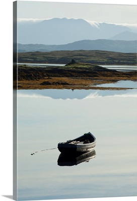 Rowboat in a tranquil lake with hills in the background near roundstone, Ireland