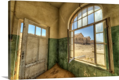 Sand in the rooms of a colourful and abandoned house, Kolmanskop, Namibia
